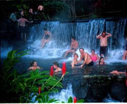 Ron and Linda Laytner join tourists from everywhere on earth at the Tabicon Spa and hot springs at the foot of Arenal Volcano. Photo from Edit international.