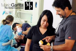 Professional staff assisting Doctor Mario Garita. Here, while Doctor planes a dental implant work