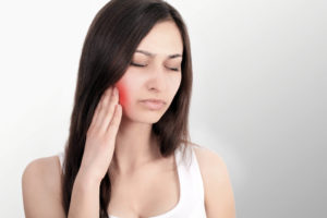 Woman seems to need surgery of wisdom teeth. Call Mario garita MP Dental Clinic